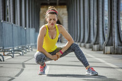 Healthy woman relaxing after workout on bridge in Paris Royalty Free Stock Photos
