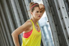 Healthy woman relaxing after workout on bridge in Paris Royalty Free Stock Image