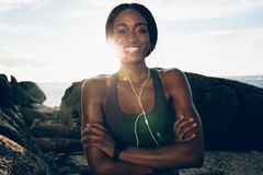 Healthy woman relaxing after workout outdoors Royalty Free Stock Images