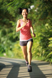 Healthy woman runner at park Royalty Free Stock Images