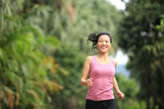 Healthy woman running at park Royalty Free Stock Photo