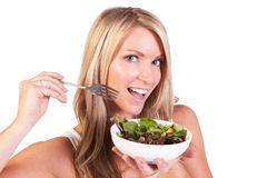 A healthy woman with salad on white background Royalty Free Stock Photography