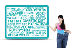 Healthy woman showing diet methods Royalty Free Stock Image