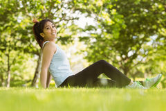 Healthy woman sitting on grass in park Royalty Free Stock Photography