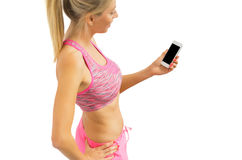 Healthy woman with smartphone Royalty Free Stock Photography