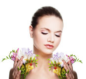 Healthy Woman Spa Model Holding Colorful Flowers. In her Hand Royalty Free Stock Image