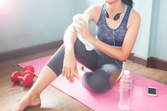 Healthy woman in sport clothing sitting on yoga mat, Workout at royalty free stock photos