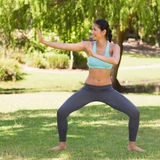 Healthy woman standing in fighting stance at park Stock Images