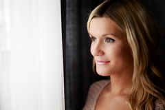 Healthy woman standing at the window. Royalty Free Stock Photos