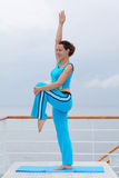 Healthy woman stands on cruise liner deck Royalty Free Stock Photos