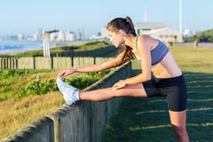 Healthy woman stretching. At the beach in the morning Royalty Free Stock Image