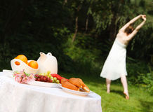 Healthy Woman Stretching Before a Summer Breakfast Royalty Free Stock Photos