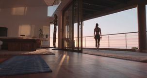 Healthy woman taking break from workout stock video footage