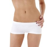 Healthy woman torso in white panties Stock Images