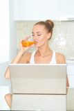Healthy woman using laptop Stock Photography