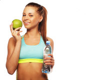 Healthy woman with water and apple diet smiling Stock Photography