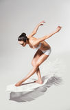 Healthy woman on white feather Stock Photo