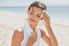 Healthy woman wipe out her sweat with towel after workout. Close up portrait of healthy woman wipe out her sweat with towel after workout stock photo
