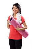 Healthy woman with yoga mat Stock Photography