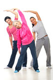 Healthy women stretching. Healthy three women workout and stretching hands  over white background Stock Image