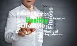 Healthy wordcloud touchscreen is operated by man.  stock photos