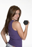 Healthy workout. Young woman with dumbbell looking back Stock Photography