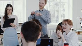 Healthy workplace. Diverse happy business people work together at team meeting at modern office slow motion RED EPIC. Healthy workplace. Diverse happy creative stock footage