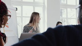 Healthy workplace. Young beautiful blonde CEO business woman leading team meeting at modern office slow motion RED EPIC. Happy smiling group of business people stock video