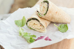 A healthy wrap with turkey, greens and cheese made Stock Photo
