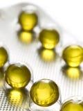 Healthy yellow pills Stock Photos