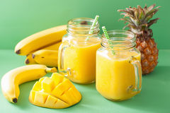 Healthy yellow smoothie with mango pineapple banana in mason jar Royalty Free Stock Photos