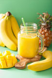 Healthy yellow smoothie with mango pineapple banana in mason jar Stock Photography