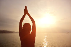 Healthy yoga woman meditation at sunrise seaside Royalty Free Stock Photography