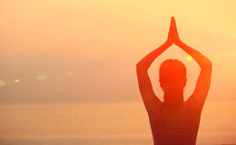 Healthy yoga woman meditation at sunrise seaside. Back of healthy yoga woman meditation at sunrise seaside Stock Images
