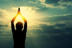Healthy yoga woman meditation at sunrise seaside Stock Photos