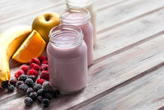 Healthy yogurts with mix of berries Royalty Free Stock Photo