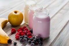 Healthy yogurts with mix of berries Stock Images