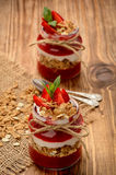 Healthy yougurt dessert with strawberry mousse, muesli and strawberries. Royalty Free Stock Photo