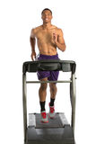 Healthy Young African American Running in Treadmill Royalty Free Stock Image