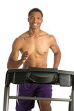 Healthy Young African American Running in Treadmill Stock Photo