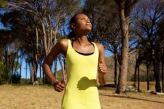 Healthy young african american woman jogging Stock Image