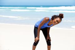 Healthy young african woman laughing at the beach Stock Photography
