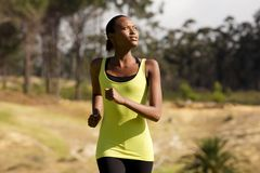Healthy young african woman running outdoors Royalty Free Stock Image