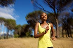 Healthy young african woman running outdoors Stock Image