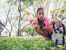 Healthy young asian woman exercising at park. Fit young woman doing training workout in morning. Royalty Free Stock Photo