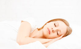 Healthy young beautiful woman sleeping in white bed Stock Photography