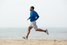 Healthy young black man. Jogging at the beach Royalty Free Stock Photos