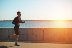 Healthy young black man jogging. At the beach Royalty Free Stock Image