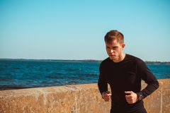 Healthy young black man jogging. At the beach Royalty Free Stock Photography