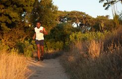 Healthy young black man jogging outdoors Royalty Free Stock Image
